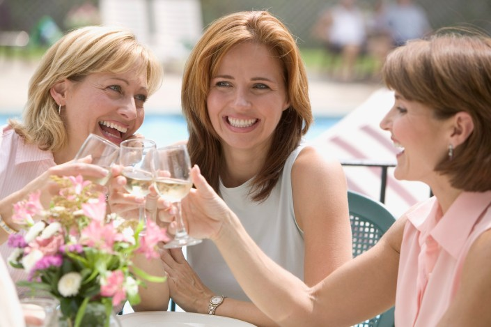 Women Toasting Wine Glasses