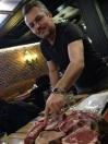 Andrei George Dusu, proprietarul restaurantului Pizzico, Constanta, trecand in revista tipurile de carne de vita din meniu.